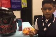 "Juan David Hernandez Rojas shows off his bullet-resistant ""safety backpack"" at the ExpoCiencias Tamaulipas science fair."