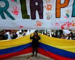 Supporters rallying for the nation's new peace agreement during a march in Bogota, Colombia