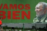 Woman walks past a billboard of Fidel Castro in Havana which says