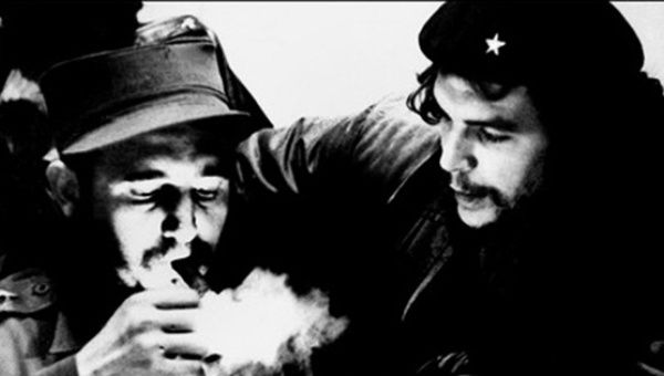 This file photo taken in the 1960s shows then Cuban Prime Minister Fidel Castro (L) lighting a cigar while listens Argentine Ernesto Che Guevara.