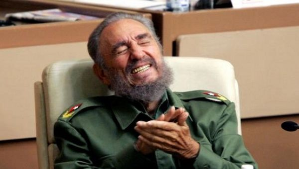 Cuban revolutionary leader Fidel Castro laughs during the year-end session of the Cuban parliament.