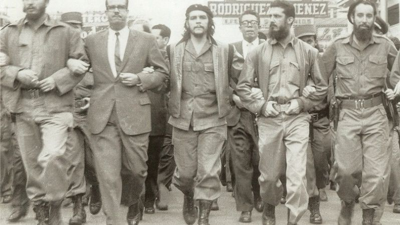 Fidel Castro (L) and Che Guevara (C) lead a memorial march in Havana May 5, 1960, for the victims of the La Coubre freight ship explosion, considered to be one of the first CIA attempts to undermine the Cuban revolution. From the outset of the victory of the revolution, Cuba and Fidel faced numerous terrorist attacks.