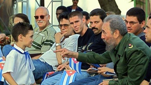 Cuban president Fidel Castro talks with Elian Gonzalez, July 14, 2001, in Cardenas, Cuba.