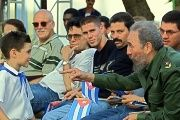 Cuban President Fidel Castro talks with Elian Gonzalez, July 14, 2001, in Cardenas, Cuba.