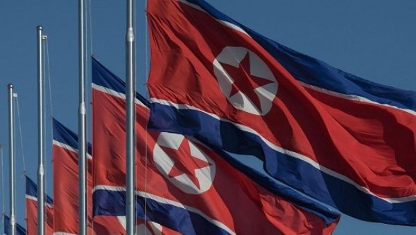 North Korean flags fly at half-mast Monday, mourning the death of Fidel Castro.