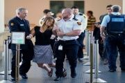 A migrant solidarity activist being removed from Australia's Parliament on Wednesday