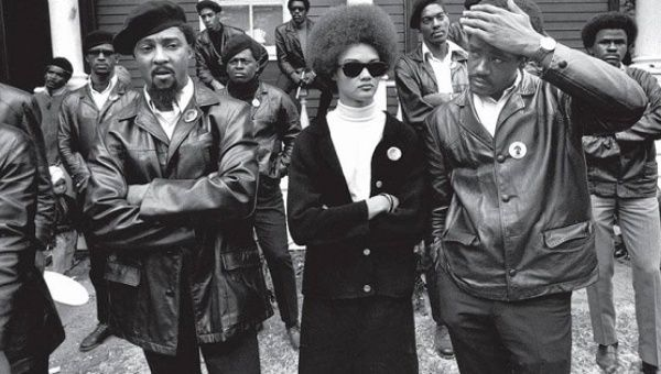"Kathleen Cleaver and Black Panther co-founder Bobby Seale (right) at a ""Free Huey"" rally in Oakland, California, in the summer of 1968."
