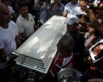 Friends and supporters carry the coffin of slain environmental rights activist Berta Caceres after her body was released from the morgue in Tegucigalpa, Honduras, March 3, 2016.