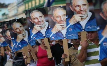 People greet the arrival of the caravan carrying the ashes of Fidel Castro in Las Tunas, Cuba on Dec. 2, 2016.