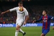 Real Madrid's Cristiano and Barcelona's Jordi Alba in action at the Nou Camp Stadium, Barcelona, Spain