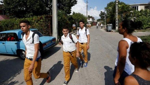 People walk on a street in Jaimanitas where Cuba