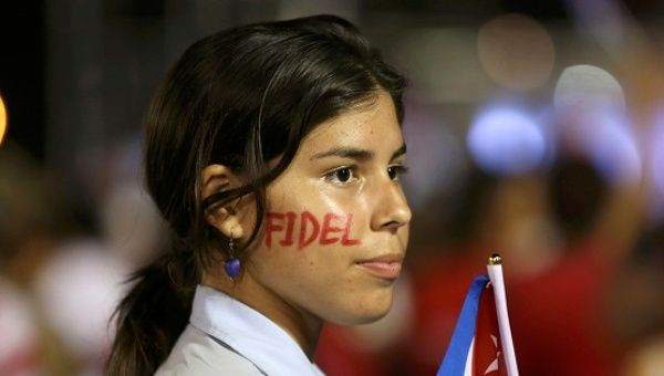 A student wearing face paint attends a tribute to former Cuban President Fidel Castro in Santiago de Cuba, Dec. 3, 2016.