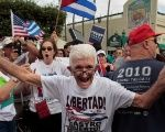People celebrate the death of Cuban revolutionary leader Fidel Castro in Miami, Florida, U.S., Nov. 26, 2016.