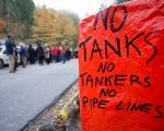 A banner against tanks, tankers and pipelines is displayed during an anti-pipeline protest in Canada.