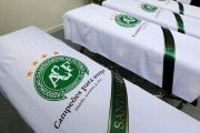 Blankets bearing the crest of Brazilian soccer team Chapecoense are placed on coffins after the deadly plane crash.