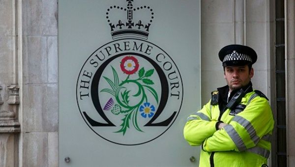 A police officer stands outside London Supreme Court.