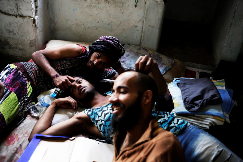 Rodrigo (R), 26, Wam (C), 24, and Teflon, 19, members of the lesbian, gay, bisexual and transgender (LGBT) community who have been invited to live in a building that the roofless movement has occupied, relax in downtown Sao Paulo.