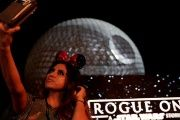 A guest takes a selfie as the Spaceship Earth is turned into the Death Star via projectors in advance of the release of the new Star Wars movie