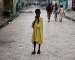 A child stands on a street after Hurricane Matthew passes Cite-Soleil in Port-au-Prince, Haiti, Oct.5, 2016.