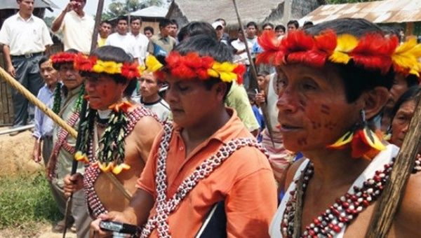 Achuar people living in the remote headwaters of the Amazon are threatened by oil exploration.