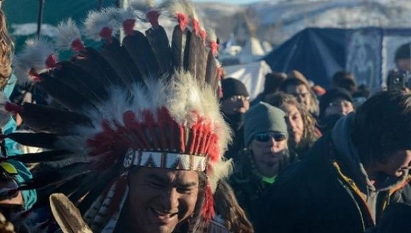 Demonstrators against the North Dakota Access Pipeline celebrate in Oceti Sakowin camp, Dec. 4, 2016.