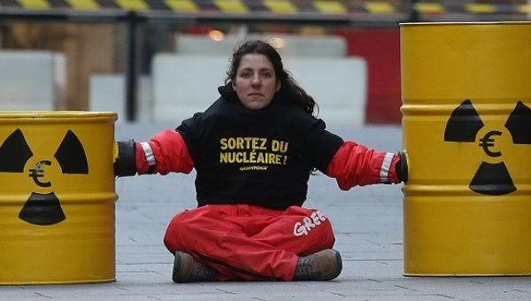 An activist blocks the entrance of the France