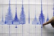 A seismologist points at a graphic showing an earthquake reading at the Central Weather Bureau in Taipei, July 14, 2009.