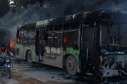 The buses were burned while en route to evacuate ill and injured people from the besieged Syrian villages of al-Foua and Kefraya, in Idlib province, Dec. 18, 2016.