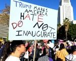 Protesters hold up signs during a march and rally against  President-elect Donald Trump in Los Angeles, California, Dec. 18, 2016.