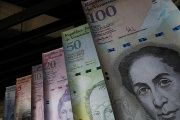 Samples of Venezuela's currencies are displayed at the Central Bank building in Caracas.