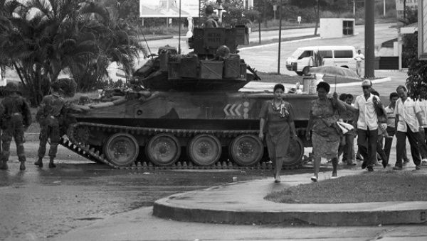 A tank patrols Panama City after the 1989 U.S. invasion of Panama.
