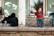 Recently diagnosed with lead poisoning, Kadin Mignery, 2, plays on the front porch of his home in St. Joseph, Missouri, U.S. Nov. 15, 2016.