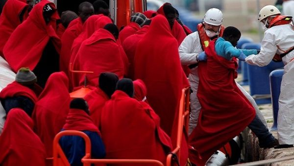 A migrant is helped by rescue workers in Malaga, southern Spain, Dec. 3, 2016.