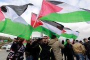 Palestinians take to the streets to celebrate the U.N. denunciation of illegal settlements.