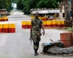 A Nigerian soldier walks past a checkpoint in Bama, Borno State, Nigeria, Aug. 31, 2016.