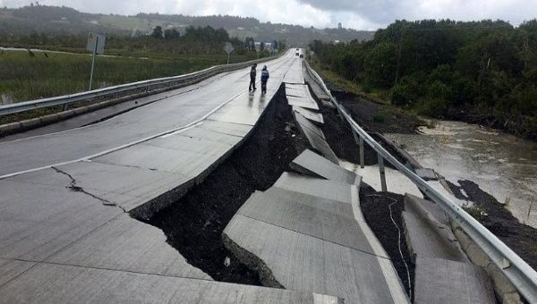 A damaged road is seen after a quake at Tarahuin, on Chiloe island, southern Chile, December 25, 2016