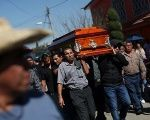 Relatives and friends accompany the coffin of a victim of an explosion at a popular fireworks market on Mexico City's outskirts, in Tultepec, December 22, 2016.
