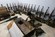 A rebel fighter of 'Al-Sultan Murad' brigade arranges weapons inside a warehouse in the northern Syrian rebel-controlled town of al-Rai, in Aleppo Governorate, Syria, Sep. 26, 2016.