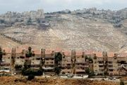 Houses are seen in the West Bank Jewish settlement of Maale Adumim as the Palestinian village of Al-Eizariya is seen in the background May 24, 2016.