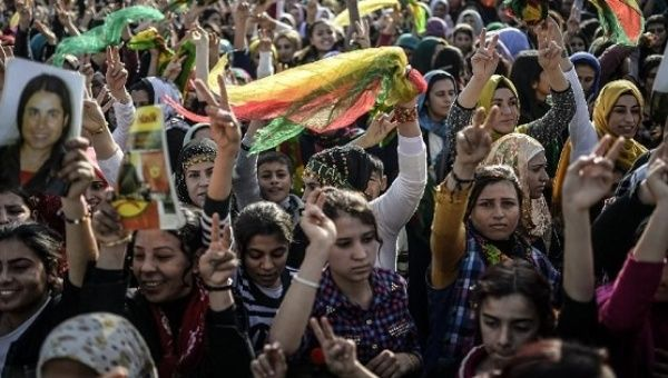 Kurdish people attend a celebration rally near the Turkish-Syrian border at Suruc, in Sanliurfa province on January 27, 2015 after Kurdish fighters expelled Islamic State group militants from the Syrian border town of Kobane.
