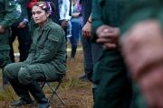 A fighter from FARC seats during the opening of ceremony congress at the camp where they prepare for ratifying a peace deal with the government, near El Diamante in Yari Plains, Colombia.