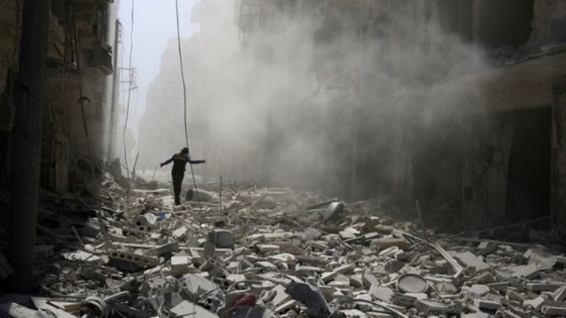 A man walks on the rubble of damaged buildings after an airstrike on the rebel held al-Qaterji neighbourhood of Aleppo, Syria Sept. 25, 2016.