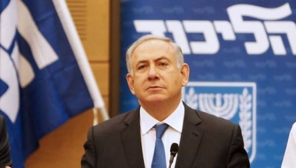 Prime Minister Benjamin Netanyahu attends a meeting of the Likud party in the Israeli parliament in Jerusalem.