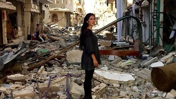 Carla Ortiz stands in war-torn Syria during filming of her upcoming documentary.