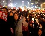 People attend a protest demanding Park Geun-hye's resignation in Seoul, South Korea, December 31, 2016. The sign reads
