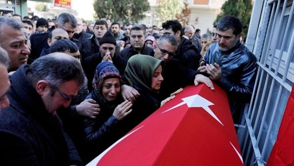 Relatives of Fatih Cakmak, a security guard and a victim of an attack by a gunman at Reina nightclub, react during his funeral in Istanbul, Turkey, Jan. 2, 2017.