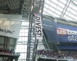 Two protesters rappel from the rafters with a banner against the Dakota pipeline during an NFL game at U.S. Bank Stadium.