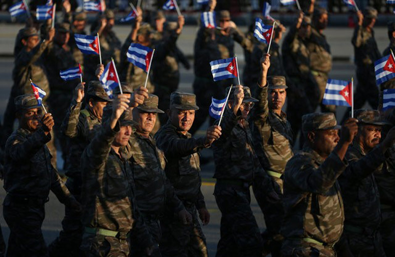 "Soldiers march to mark the Armed Forces Day and commemorate the landing of the yacht Granma, which brought the Castro brothers, Ernesto ""Che"" Guevara and others from Mexico to Cuba to start the revolution in 1959, in Havana, Cuba, Jan. 2, 2017."
