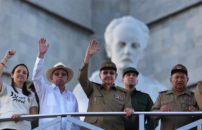 Cuban President Raul Castro (c), accompanied by the second secretary of the Communist Party of Cuba, José Ramón Machado (2-i), Minister of the Revolutionary Armed Forces, Leopoldo Cintra Frías (d), and the president of the Federation of University Students, Jennifer Bella (i), heads the military parade for the 58th anniversary of the Cuban Revolution today, Monday, January 2, 2017, in the Plaza de la Revolucion de La Habana (Cuba).