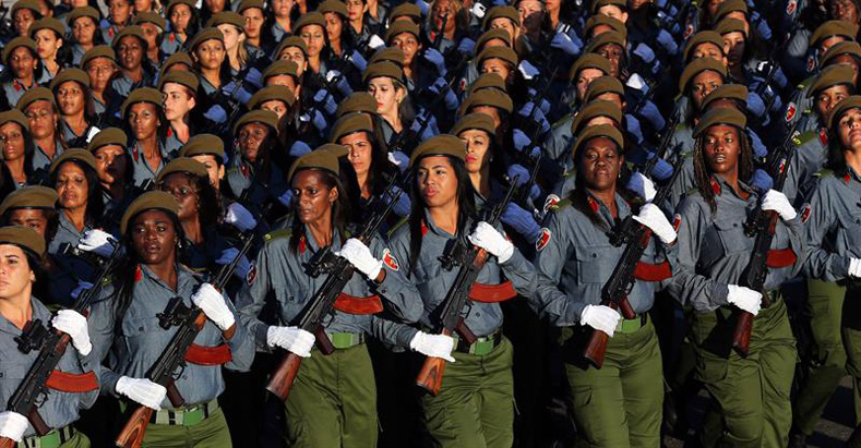 Soldiers parade at the military parade for the 58th anniversary of the Cuban Revolution today, Monday, Jan. 2, 2016, in the Plaza de la Revolución de La Habana (Cuba).